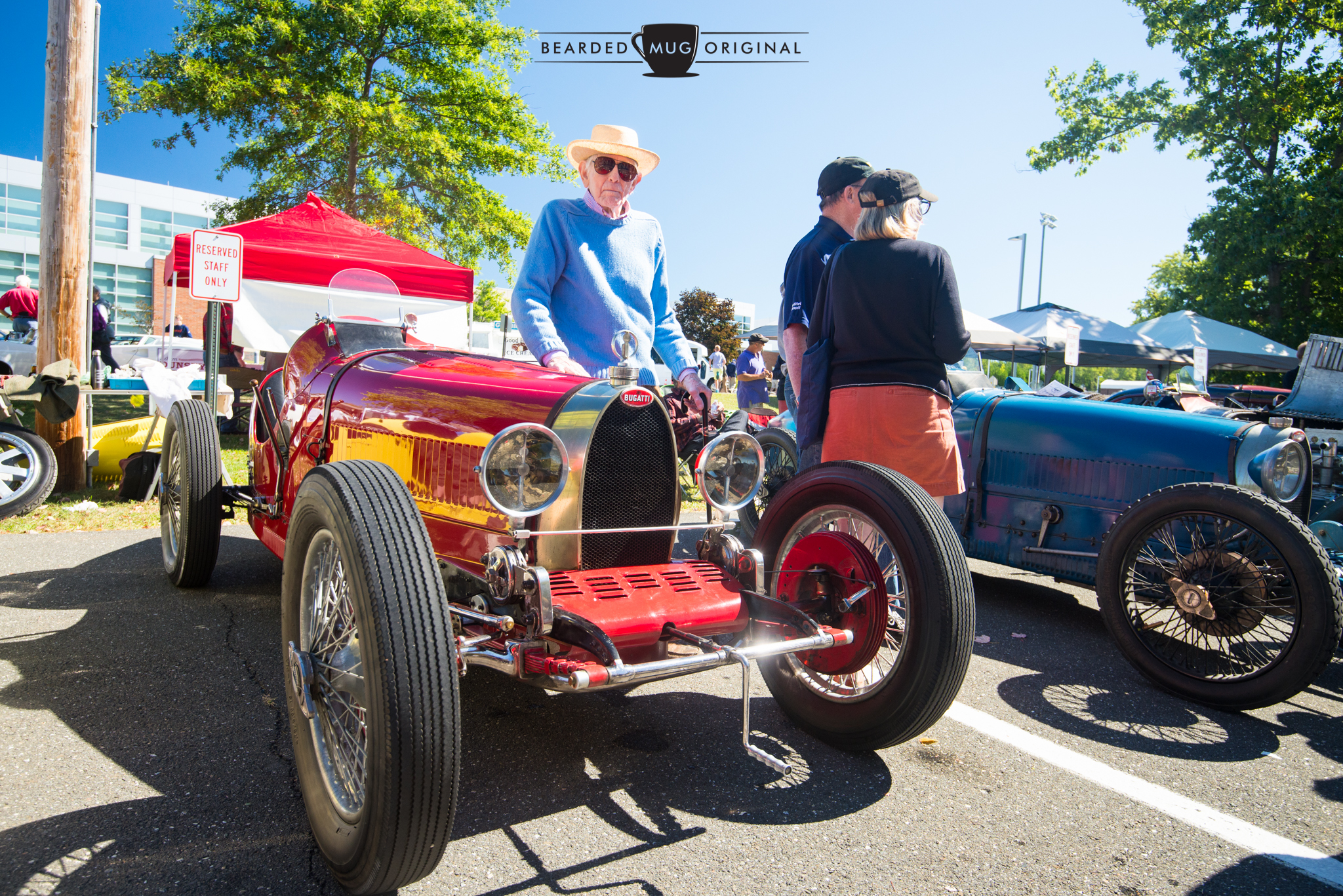 Alden Sherman stands proudly next to his Bugatti Type 35 that he drove himself to the show.