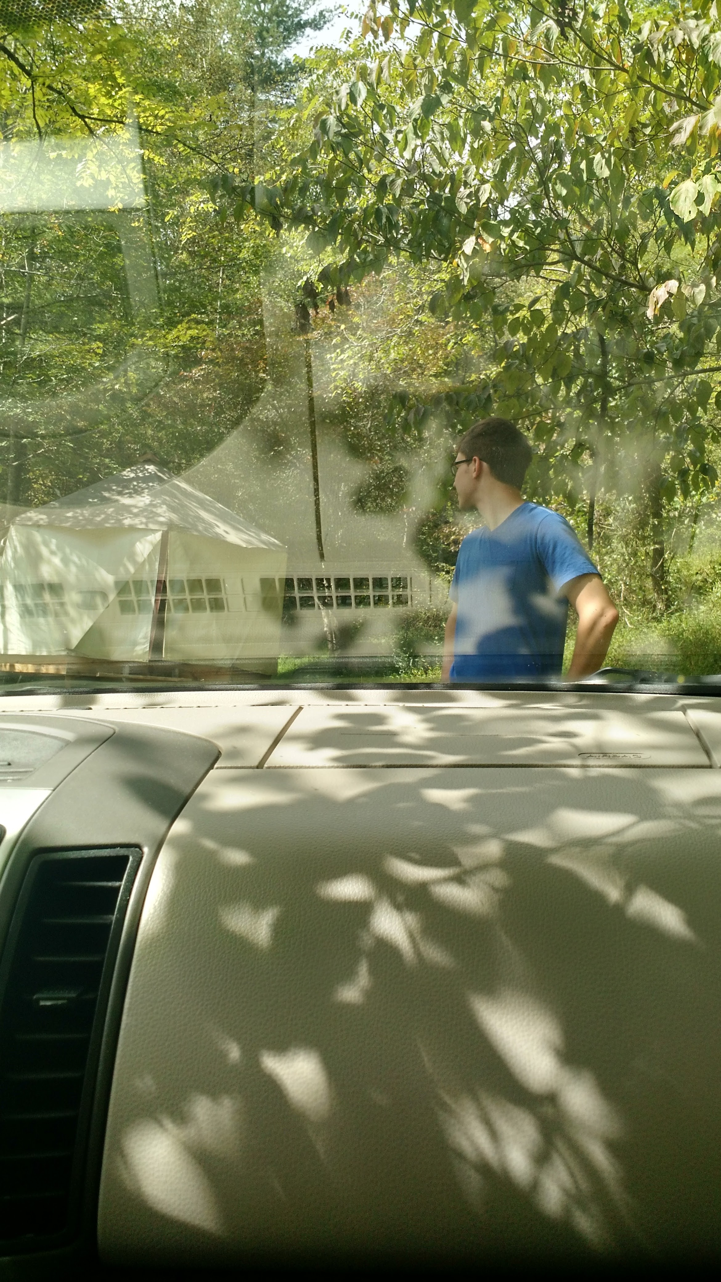 The moment I ran to the car for safety, leaving poor Tom outside knowing he chose terrible accommodations! We laughed.