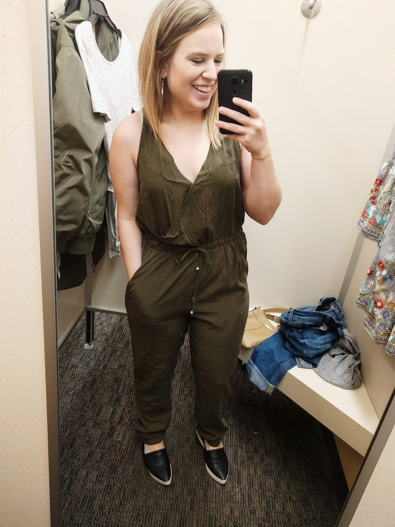 We went shopping for travel stuff and I tried on this jumpsuit for kicks. It was so awkward and made me look like I had Kim K's booty. So funny.