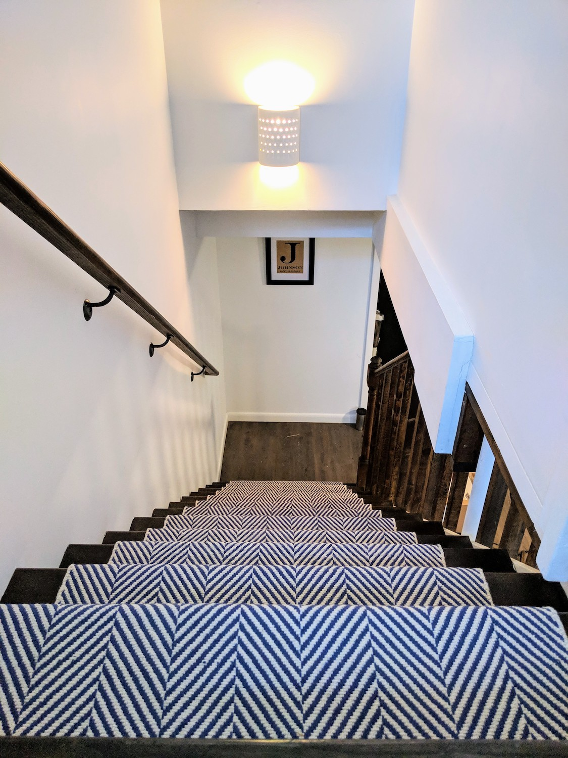 """Stair Runner - To do this project, we ordered three 2'6""""x 8' runners and Tom used a staple gun to secure it. We followed this tutorial by Young House Love."""