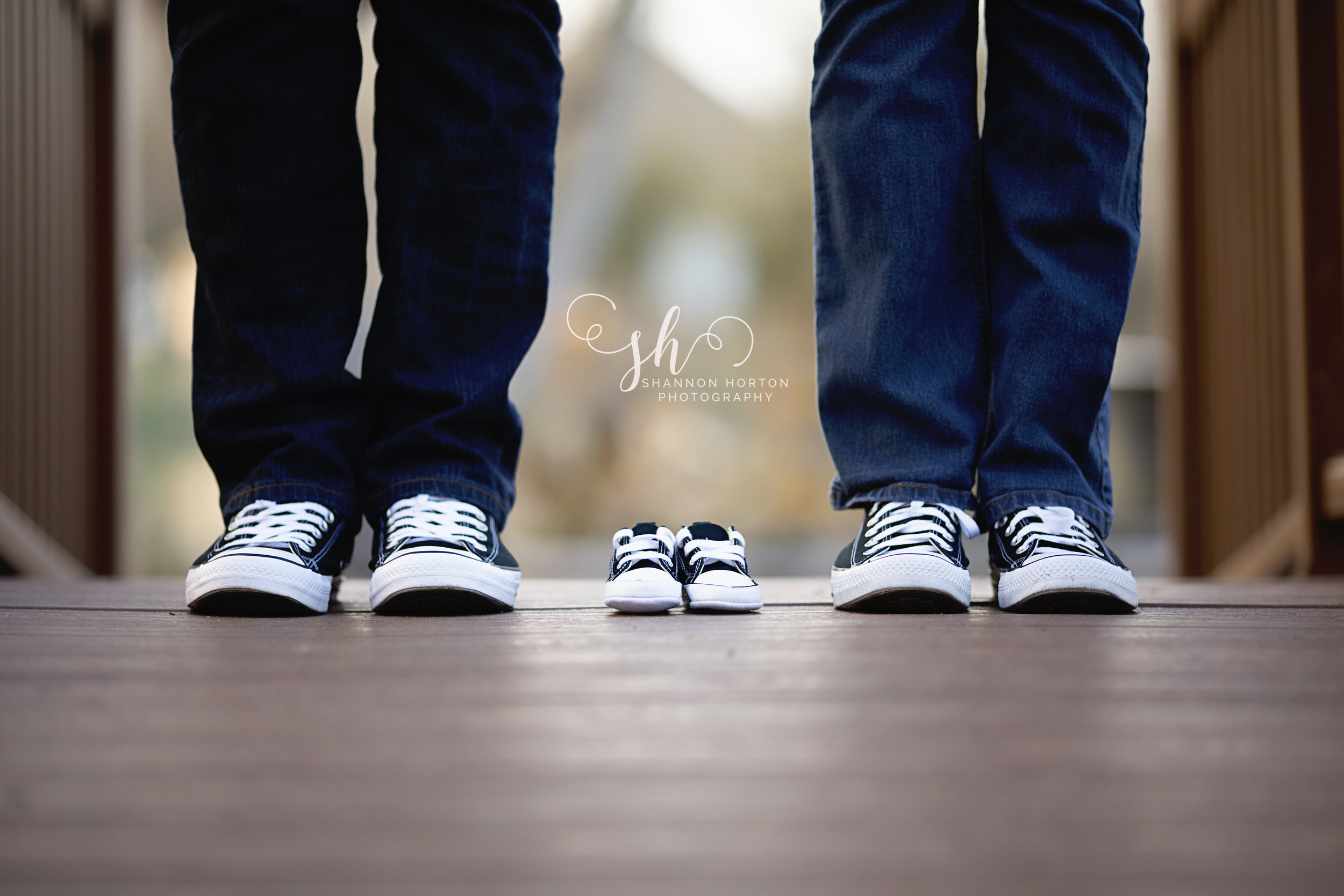 parents-and-new-baby's-shoes