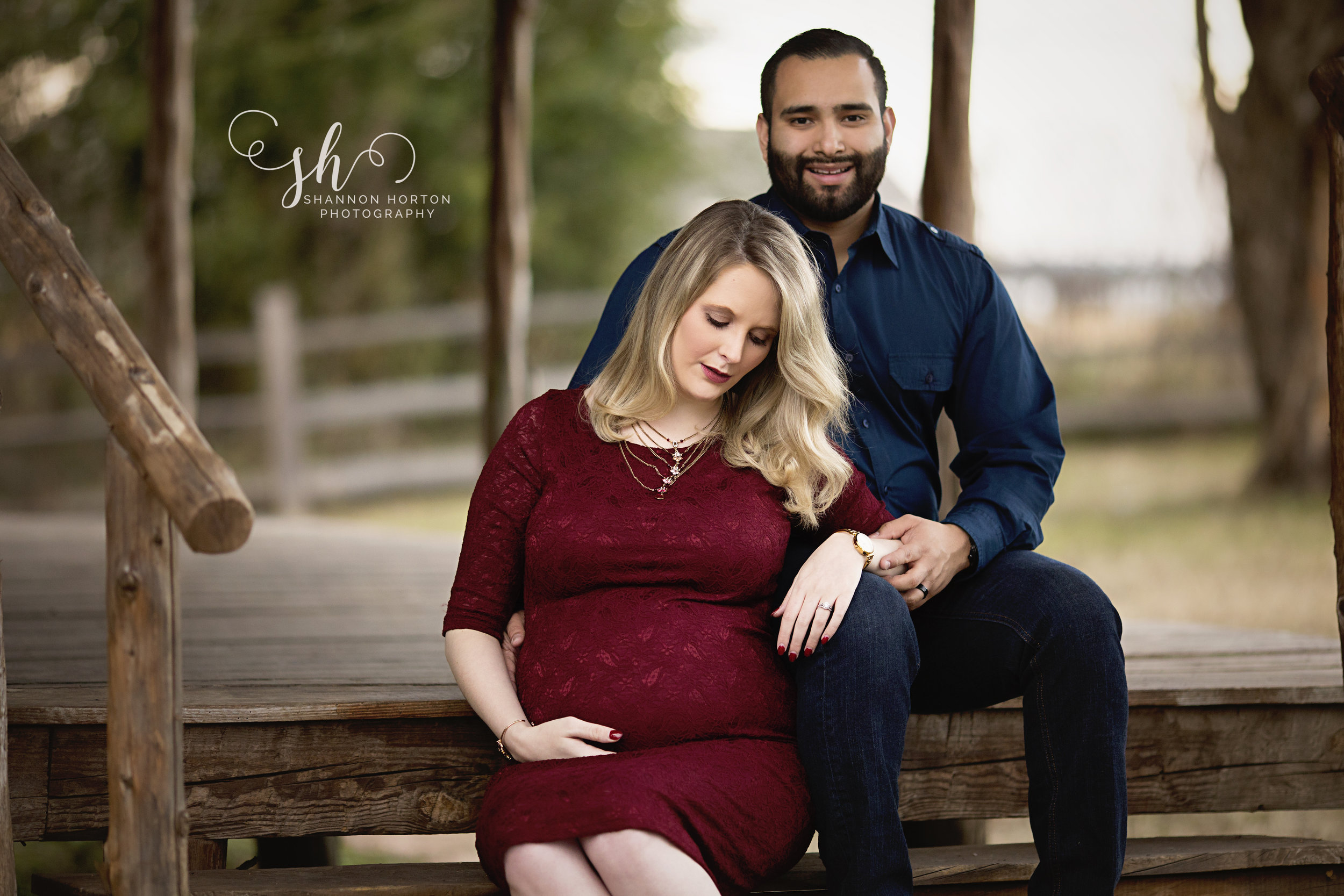 pregnant-couple-sitting-on-wooden-steps
