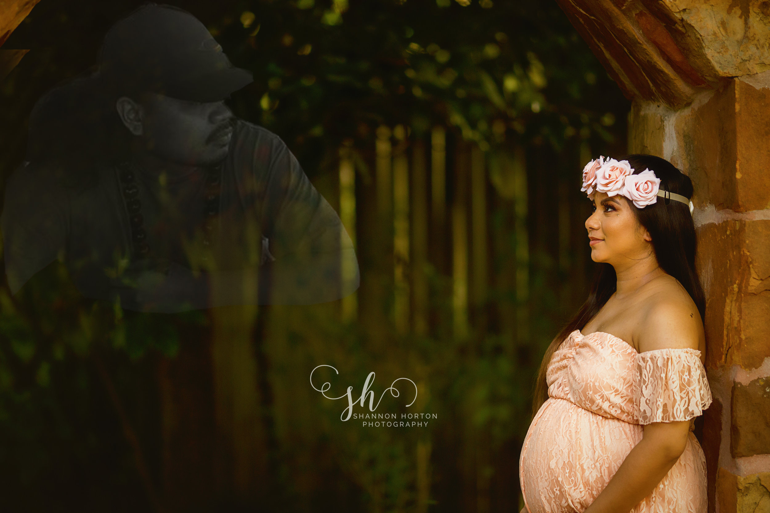 pregnant-mother-looking-up-at-image-of-late-husband