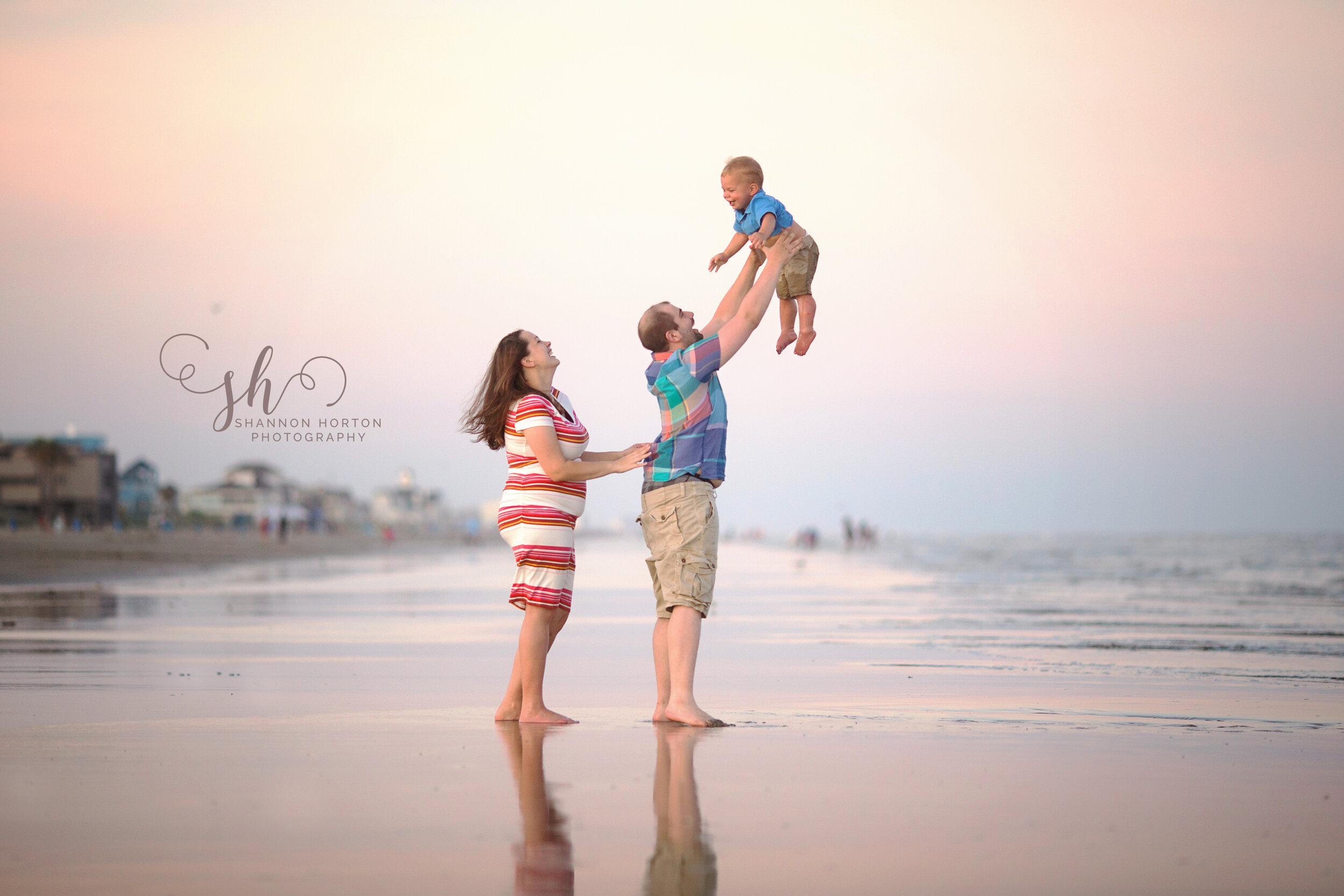 expectant-couple-toss-toddler-up-in-air