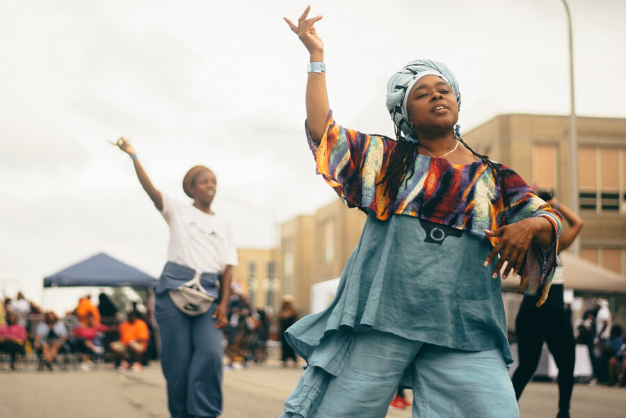 Asadah KIrkland (foreground) from South Shore dances to the musical stylings of DJ Duane Powell at 3YB. Asadah says it's nice to come to a party that is in the neighborhood.