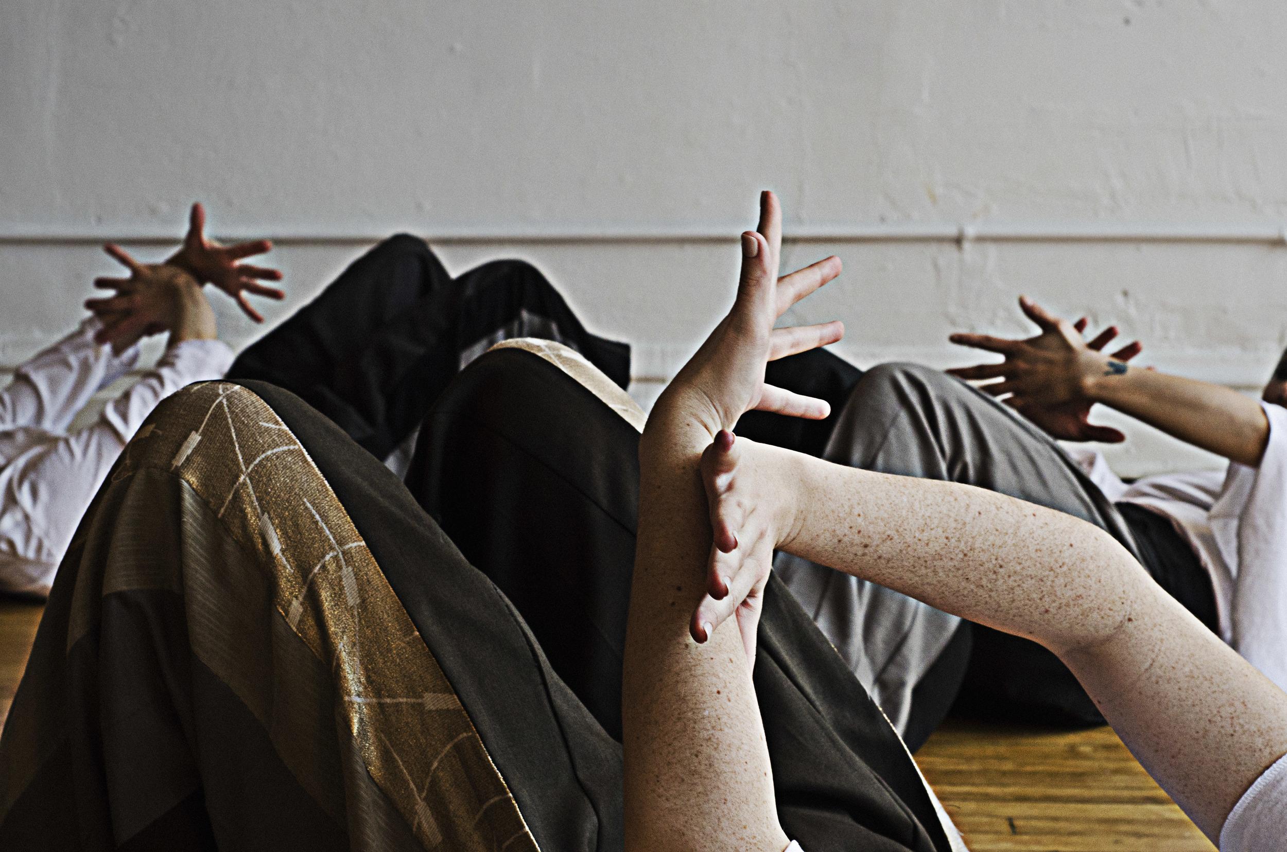 crossed hands 3 sets.jpg