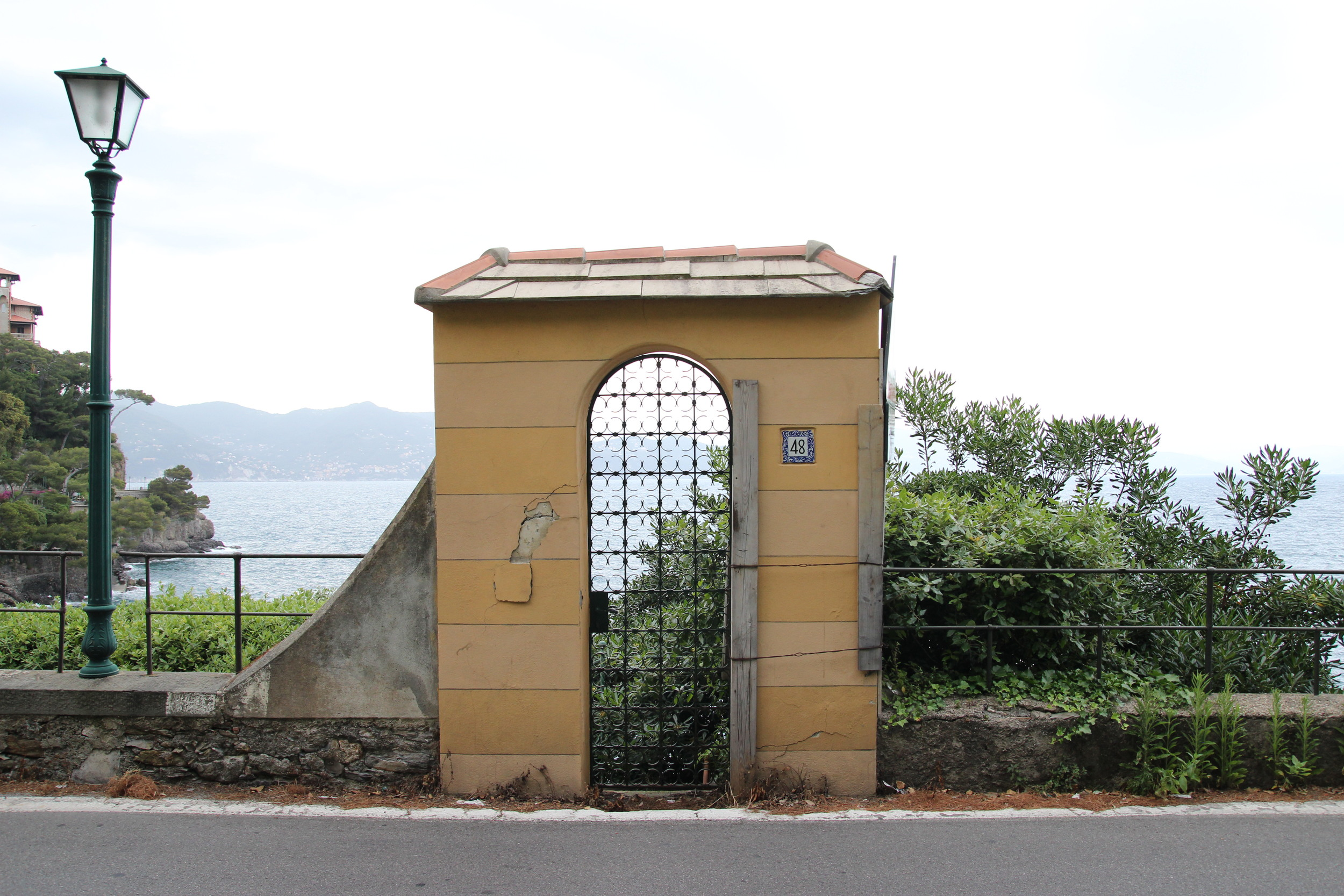 PORTOFINO  Walking along the road pasttiny villages to one of the most beautifully urbaneharbor towns in the world, we came across this doorway. Literally a door to the Ligurian Coast.