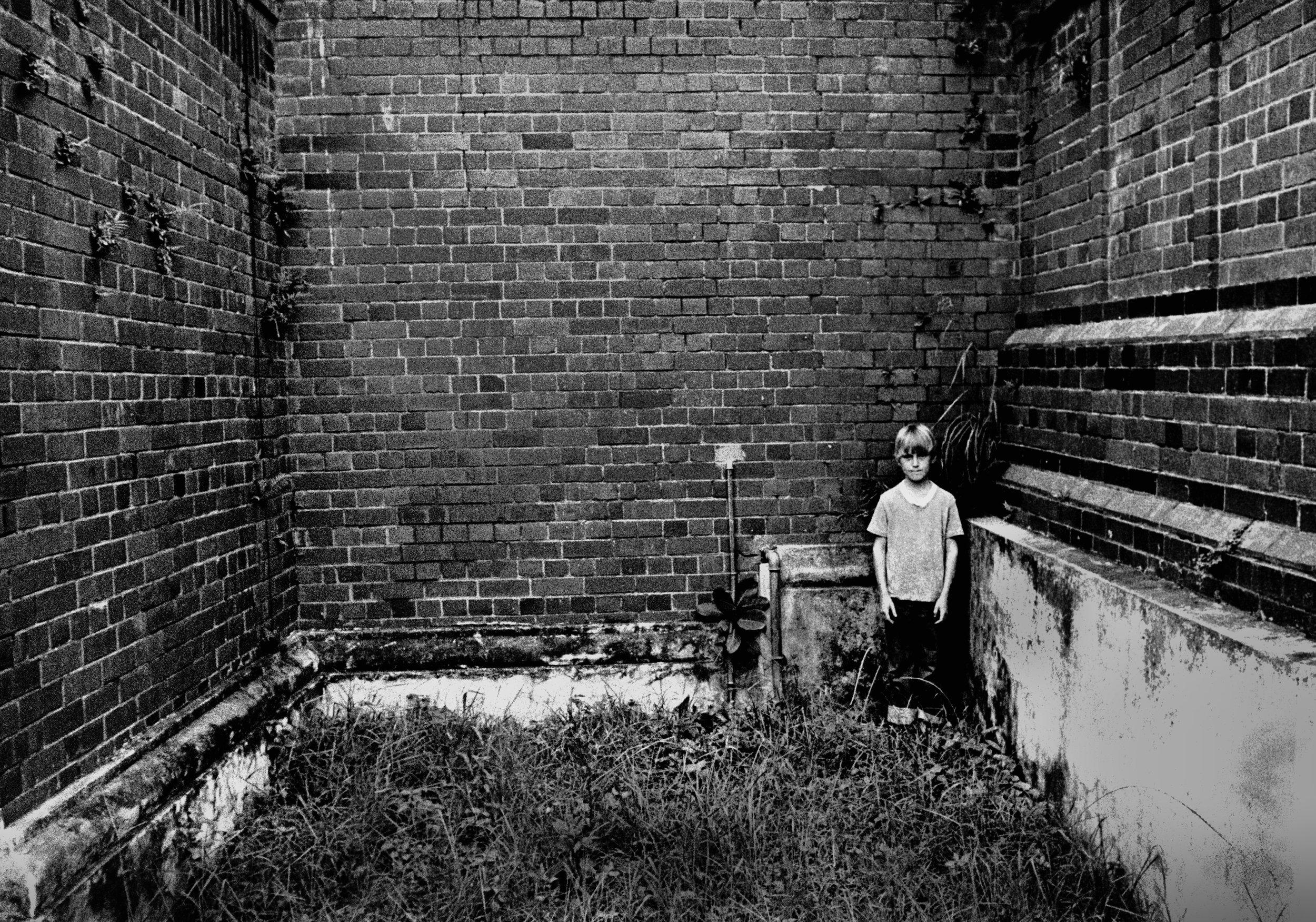 Boy hiding, Durban, South Africa, 1977