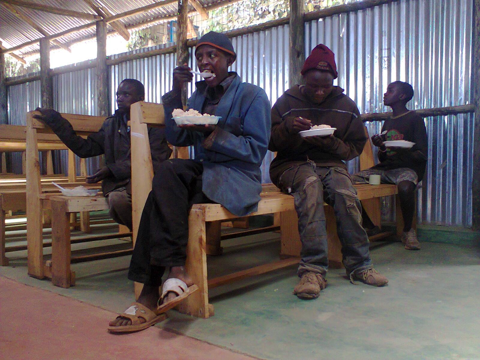boys enjoying lunch_1.jpg