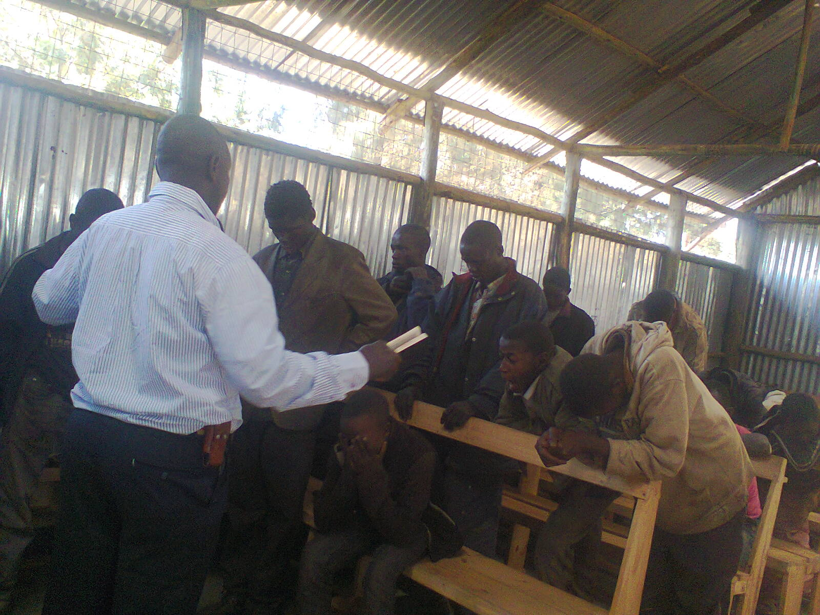 Church leader ministers to street children at outreach