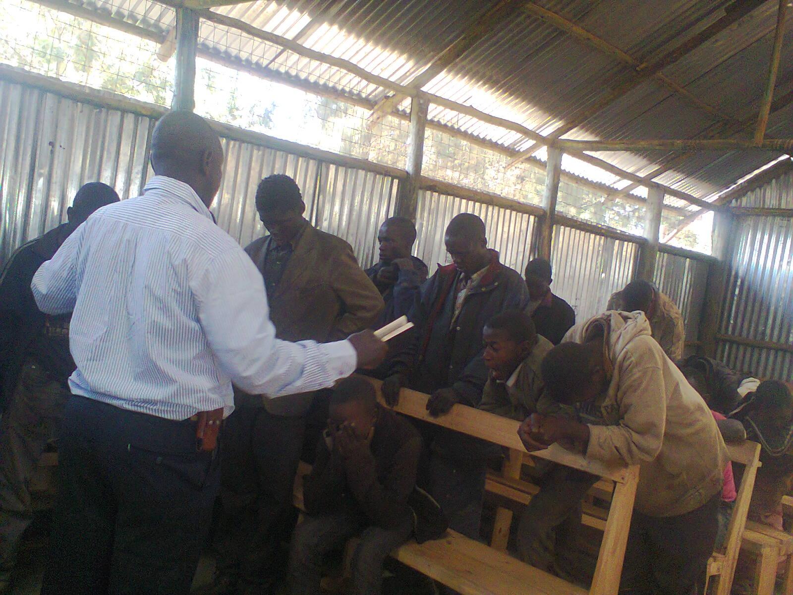 Vincent teaching the boys how God loves them from John 3.jpg