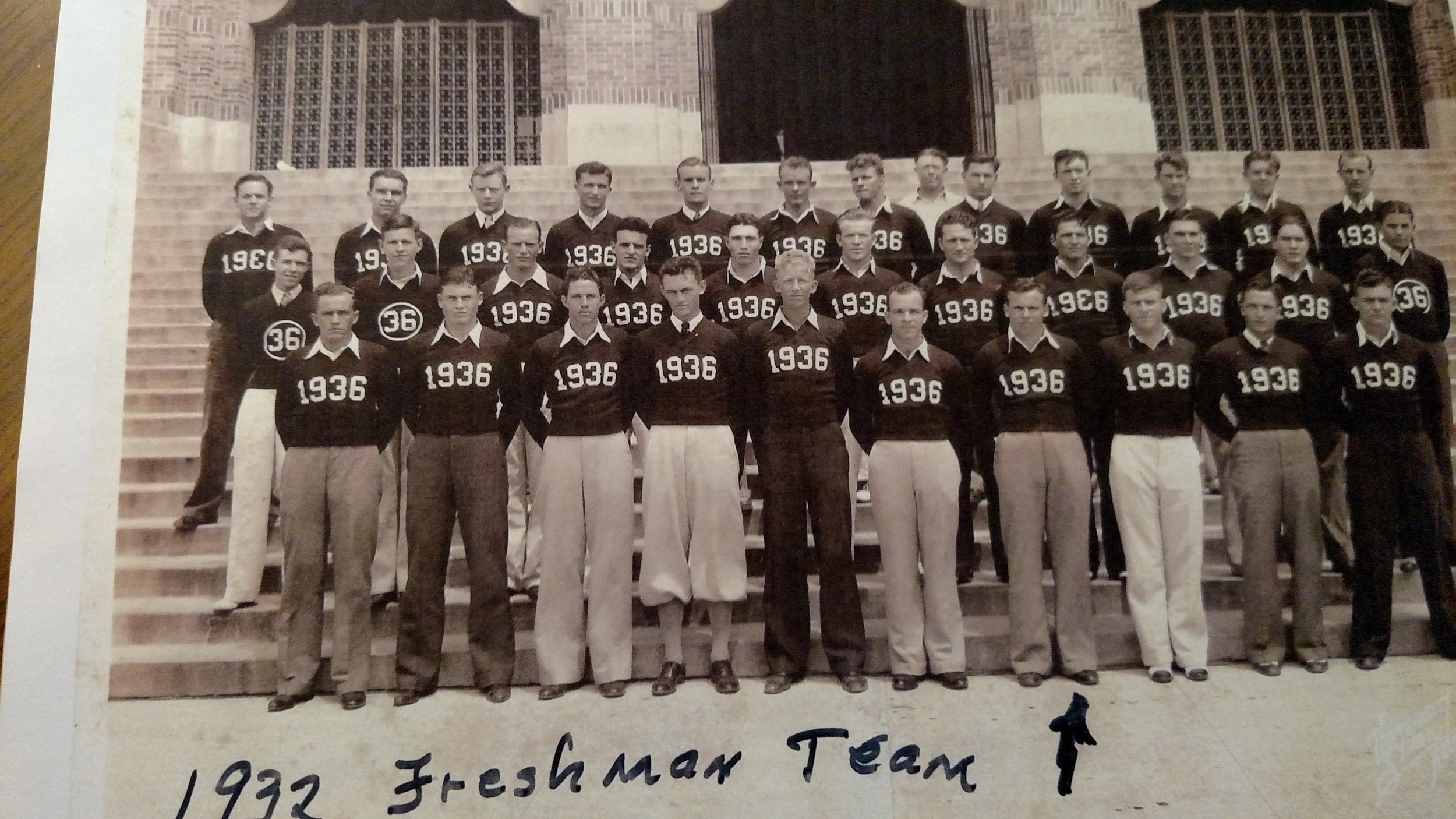 John Henderson is 4th from right on bottom row. As of September 2016 he is 103 years old in good health and very active. He is the oldest living Texas athlete of all time.