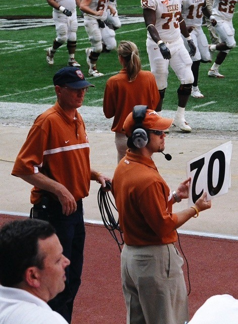 Darren Damewood holding card to notify defense of offense back # on the field.jpg