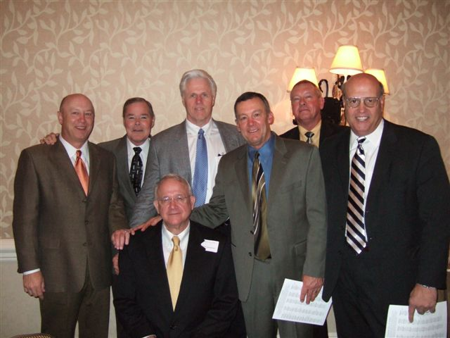 """Paul Robichau, Billy Dale, Scott Palmer, Stan Mauldin, Mack Mckinney, and Randy Stout celebrate Scott Hendersons induction into the Hall of Honor. Scott was tagged with the name """"old man"""" by his teammates when he played in college. He has not changed one bit since then."""
