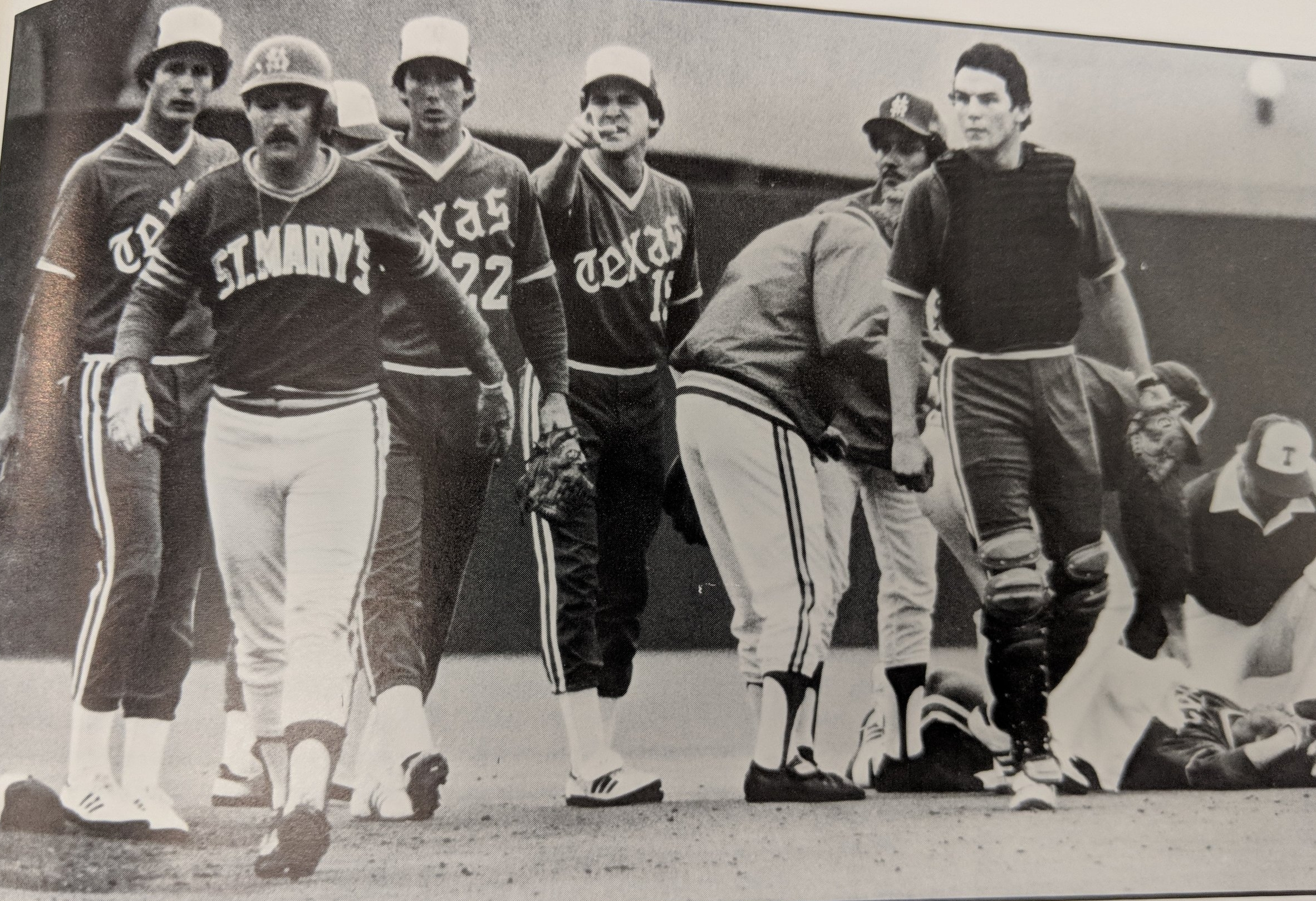 St. Mary's Steve Rambie walks away from second base as Texas players taunt him after a collision with Texas David Dean. David was lost for the season.