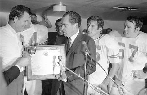 Glen as Captain is #67 is on the podium with DKR, President Nixon, Juan Conde, and James Street after the 1969 Arkansas game.