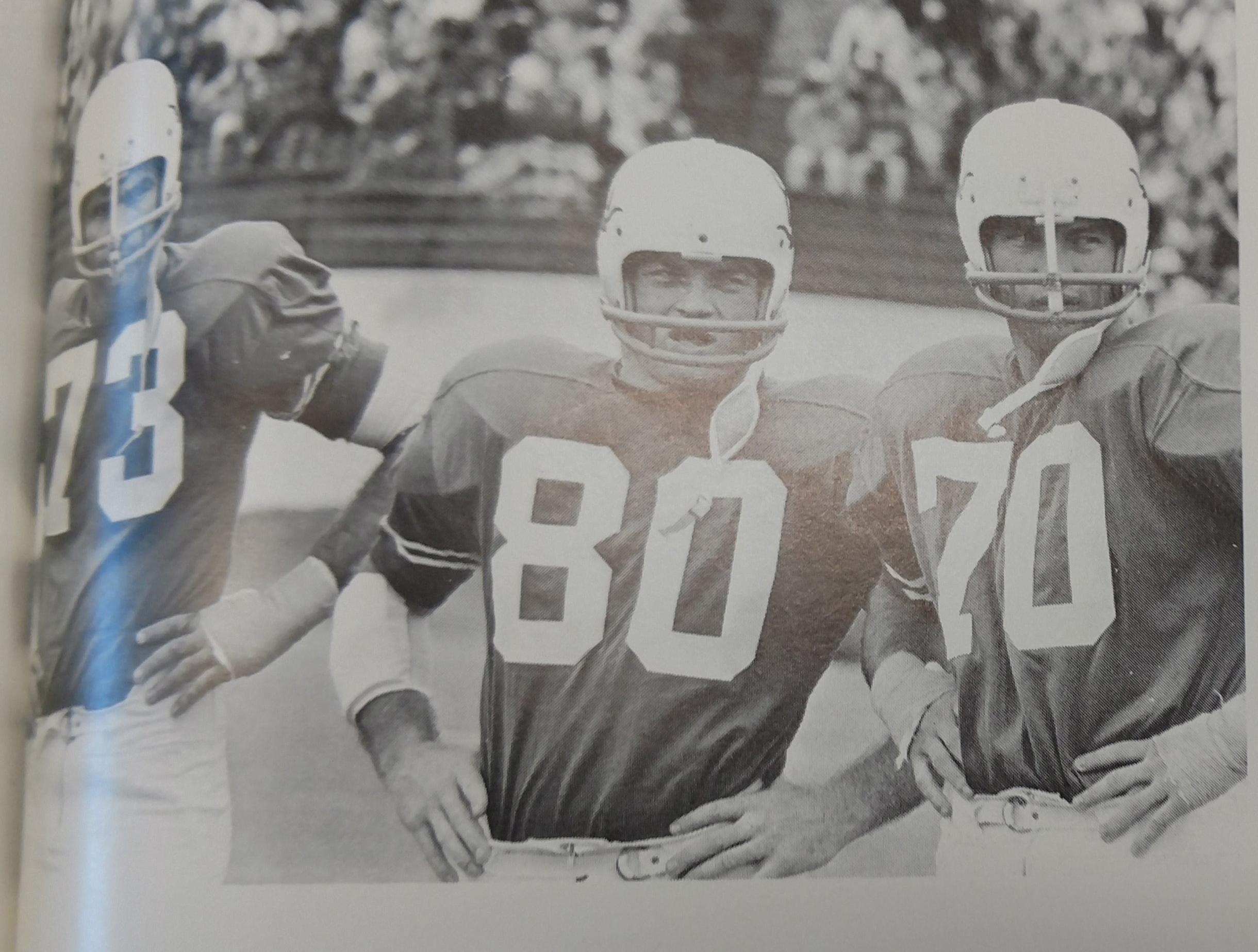 Tri Captains Diron Talbert, Barney Giles, and John Elliott