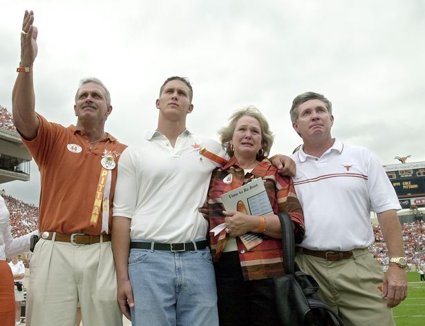 The Pittman family with Coach Brown honoring Cole at a Longhorn game.