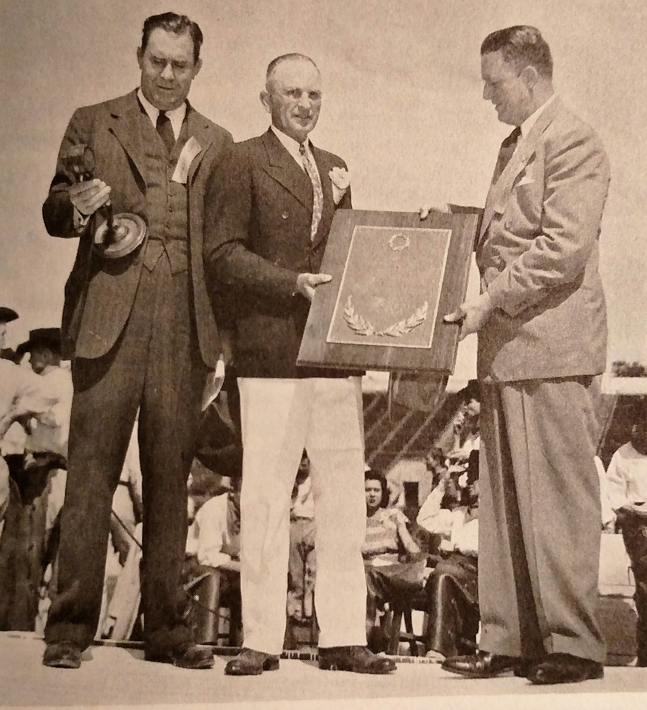 Clyde receiving an award from C.B, Smith and Tiny Gooch -