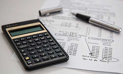 A calculator on top of legal documents