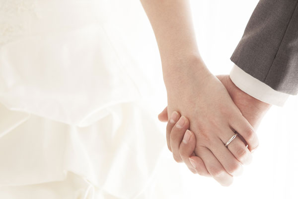 Newly married couple holding hands