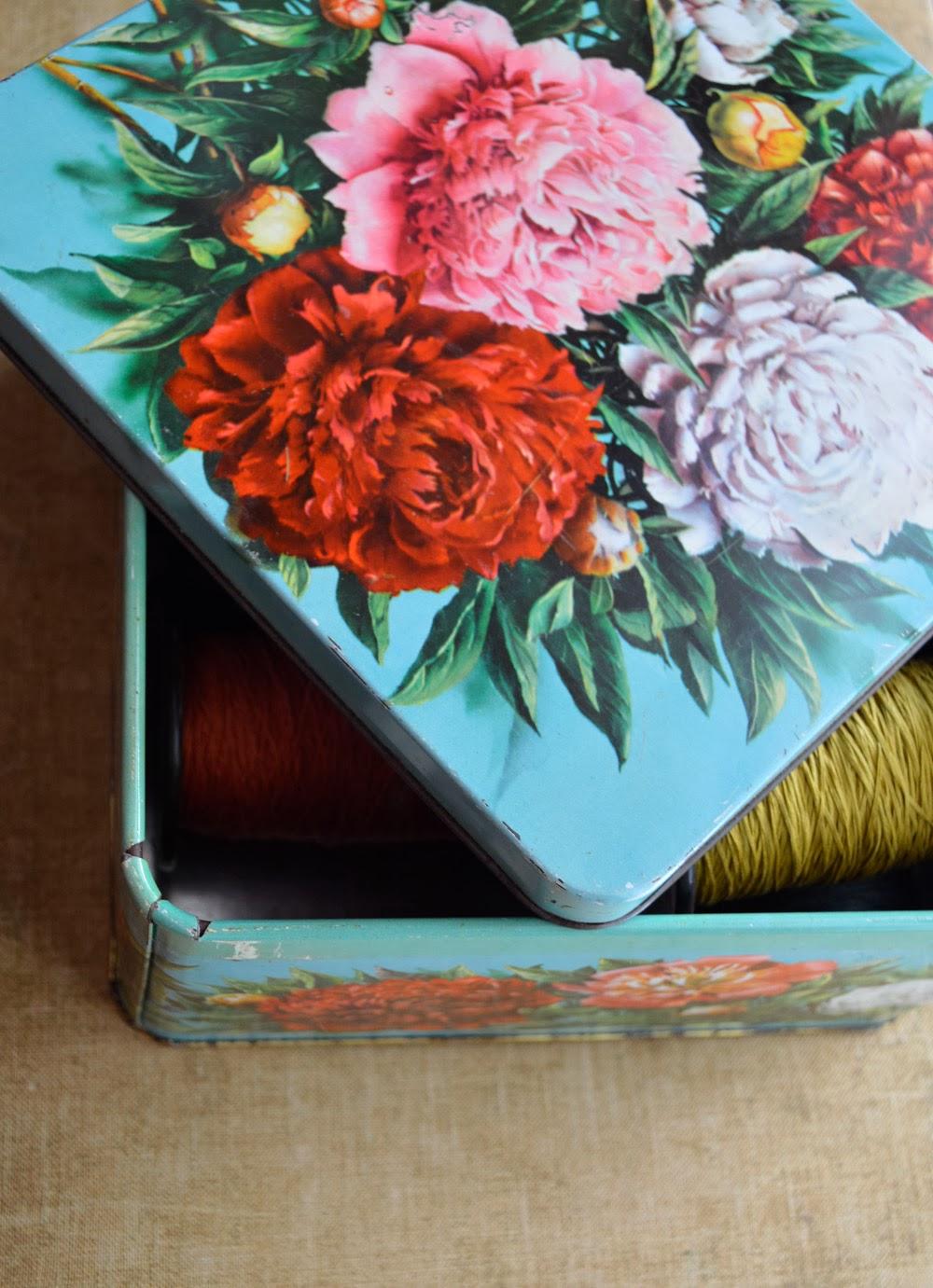 untold imprint vintage tin
