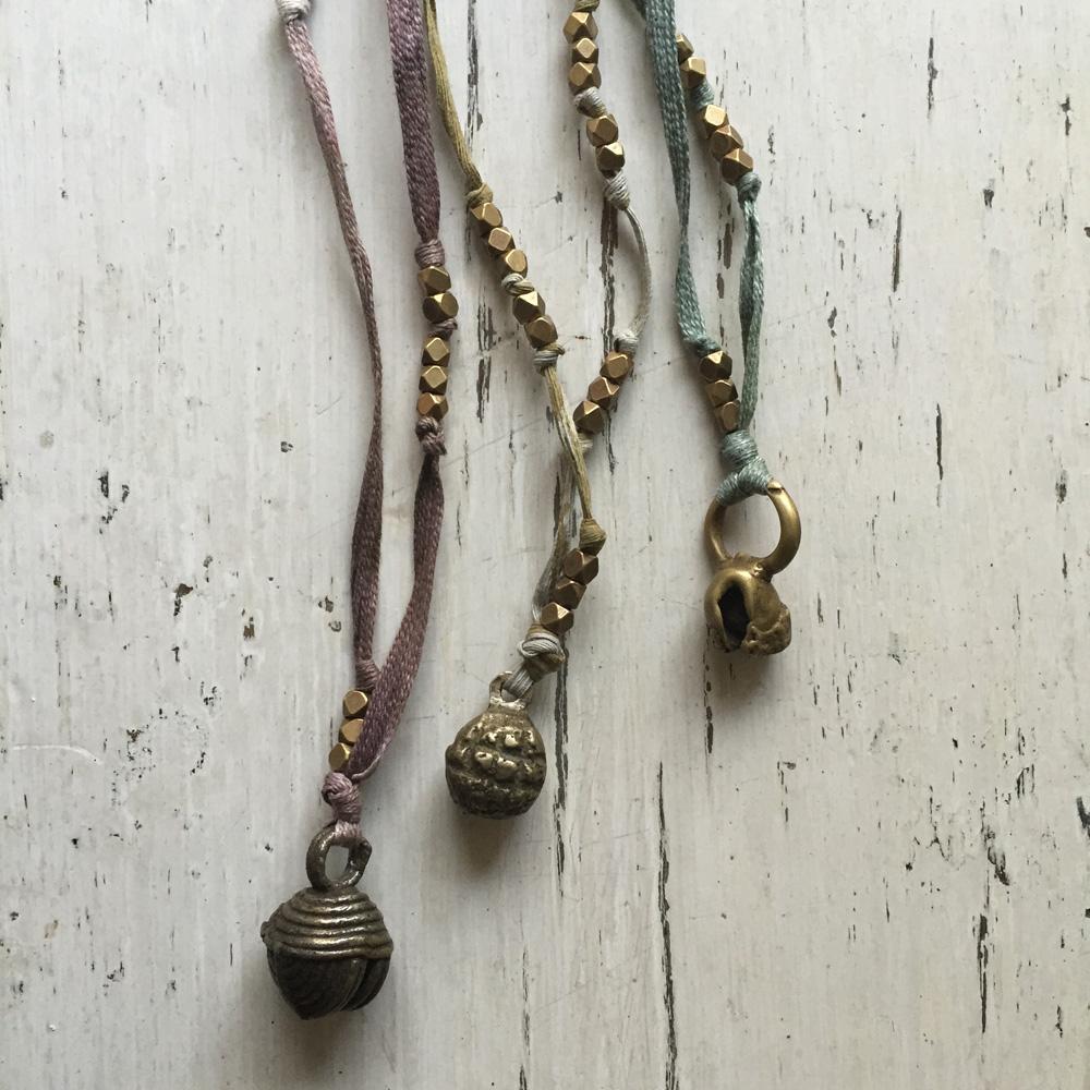 vintage brass bells and Lisu button textile necklaces
