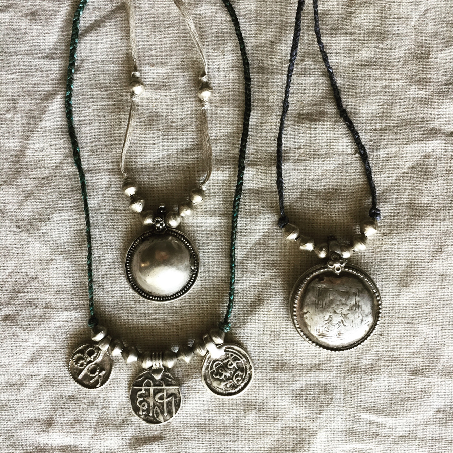 Andali, Three Amulets, & Muse necklaces made with vintage amulets from India on silk & linen.