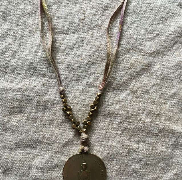 my favorite Thai monk necklace restrung on the cotton taping shown above.