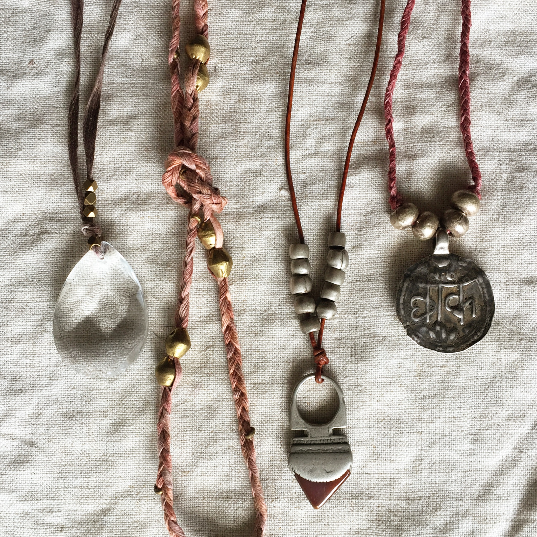 collection textile necklaces with vintage amulets and beads by Untold Imprint