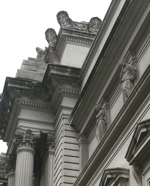 exterior of The Metropolitan Museum of Art on a gray day.