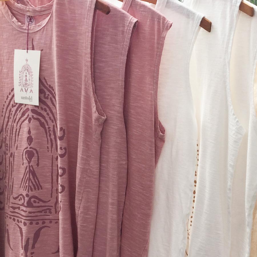 Divine Fem & Buddha print sleeveless tees by Untold Imprint