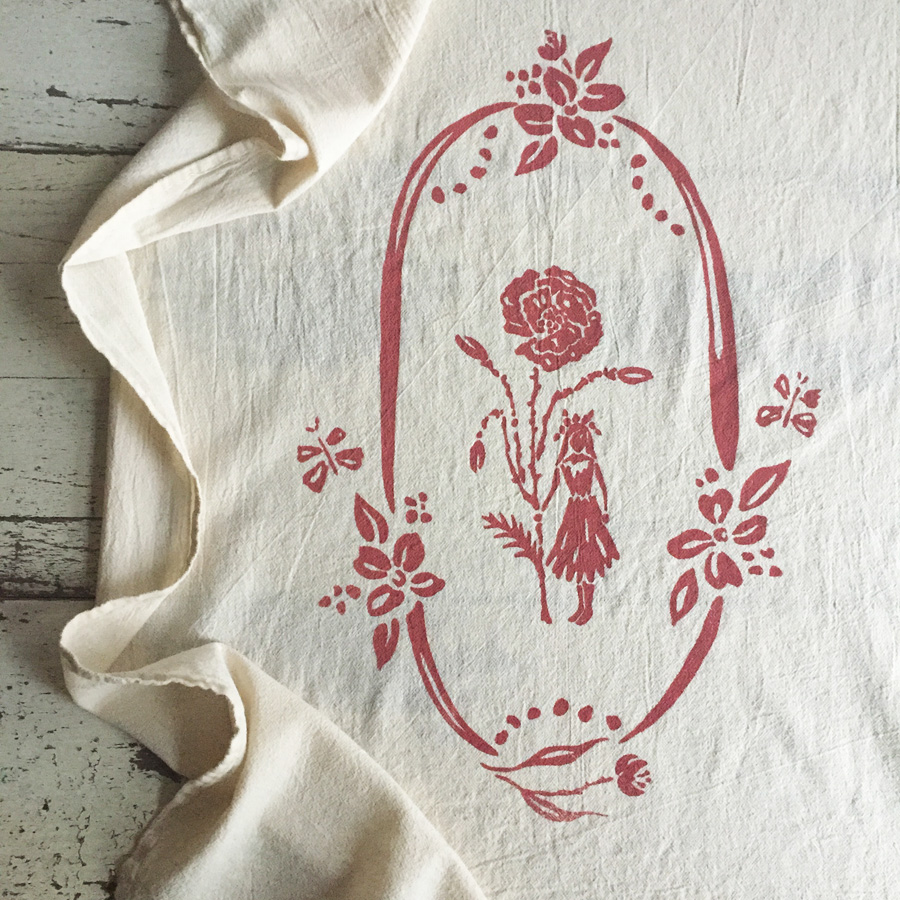 Wonder Altar printed towel in poppy red by Untold Imprint