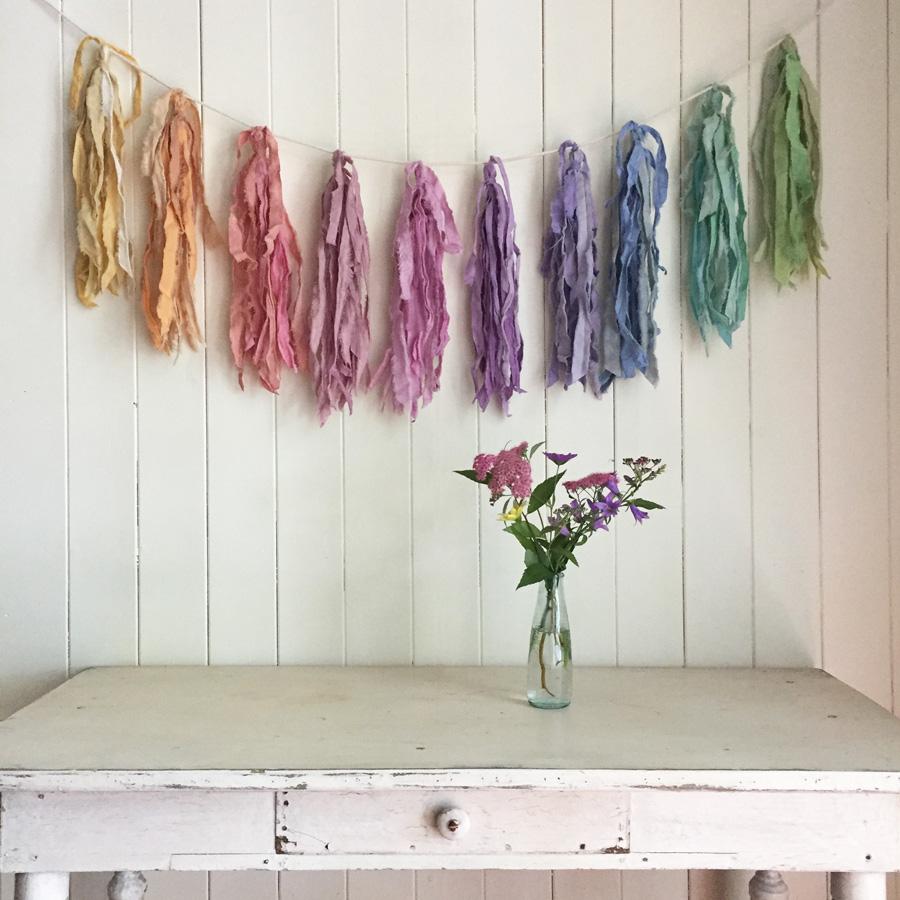Torn fabric tassel garland by Untold Imprint