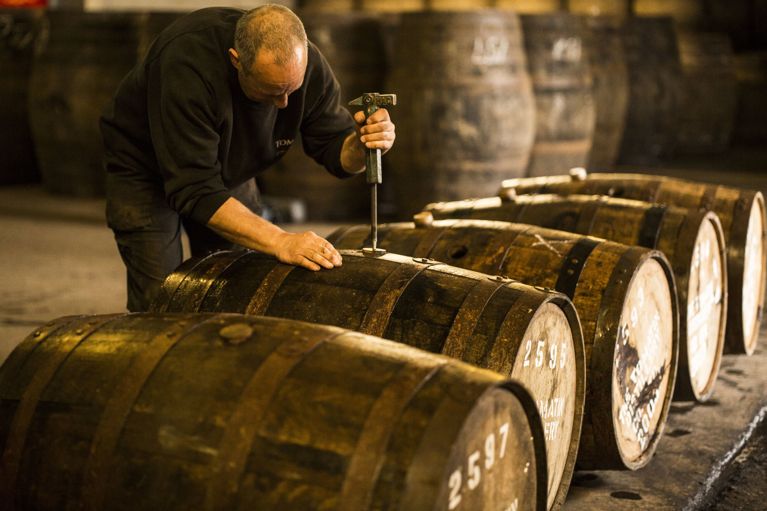 TOUR TIMES 11.40am 3.20pm Friday 17th of May   Join our Stillman, David Milne, for a bespoke tour of Tomatin Distillery where he will offer a unique insight into what exactly makes Tomatin single malt. Enjoy unrivalled access to all aspects of whisky production from malt to maturation, finished with a working cooperage demonstration. Taste our surprisingly sweet & mellow new make spirit & a selection of four Tomatin Single Malt expressions throughout this tour. Allow at least 1hr 30minutes. This tour includes the optional tasting of our new make spirit as well as whiskies;  Tomatin 12 Year  Old,  Tomatin Cask Strength ,  Tomatin 14 Year Old , &  Tomatin 18 Year Old.  Over 18s only, £25.  Contact  TOMATIN VISITOR CENTRE  to book.