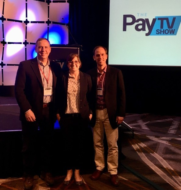 Telogical Systems at the  Pay TV Show . L to R: Andrew Woessner, Ashley Brazeal, and Michael Buening
