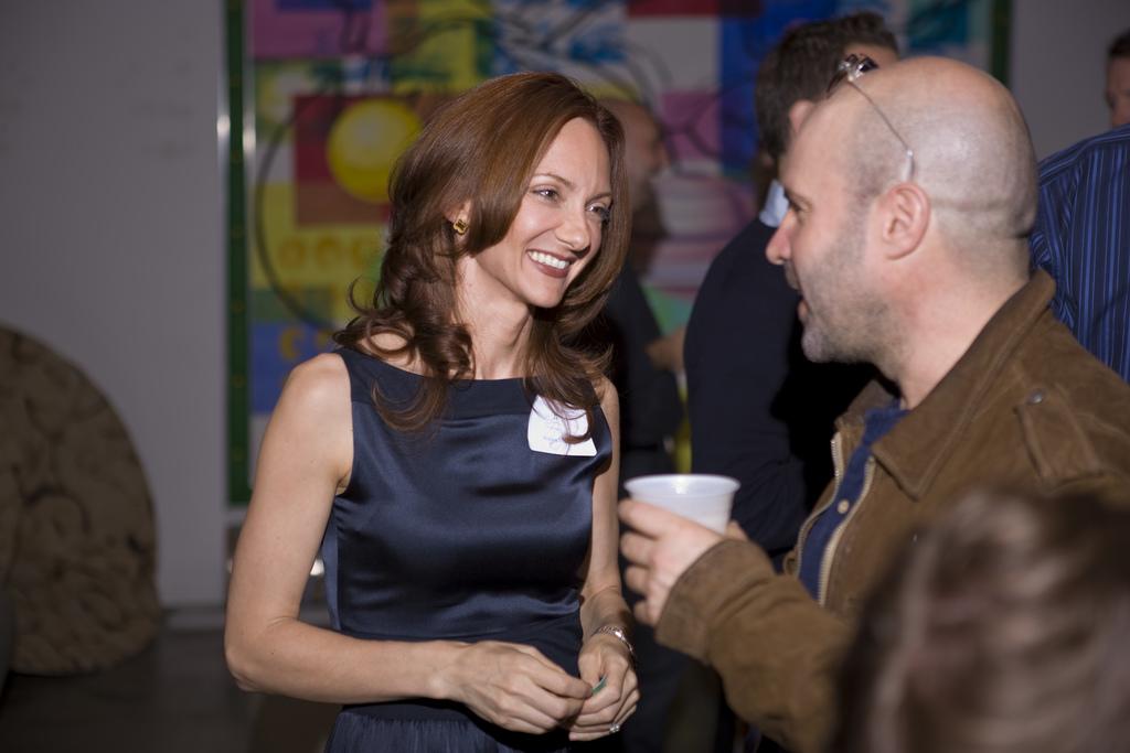 Host Victoria Hopper with Hollywood Hill Advisor Scott Z. Burns