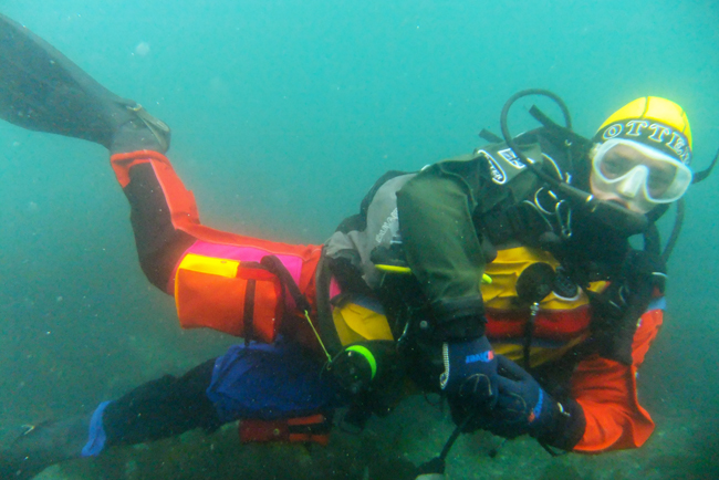 Colorful Drysuits help identify you underwater in poor visibility!