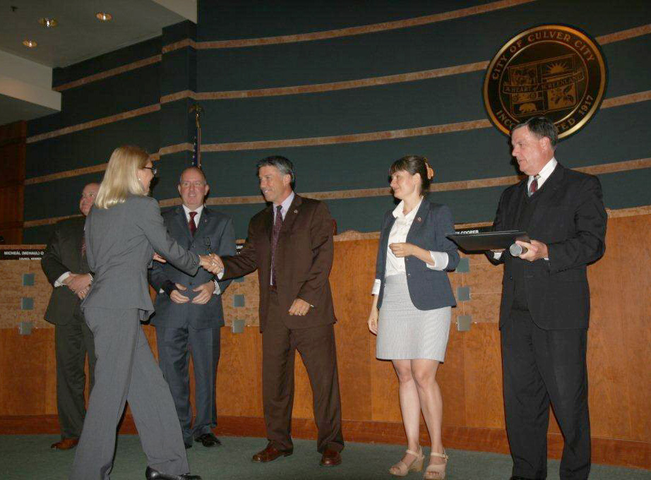 Christine-Hardin-Receiving-Outgoing-Commissioner-Certificate-fixed1.jpg