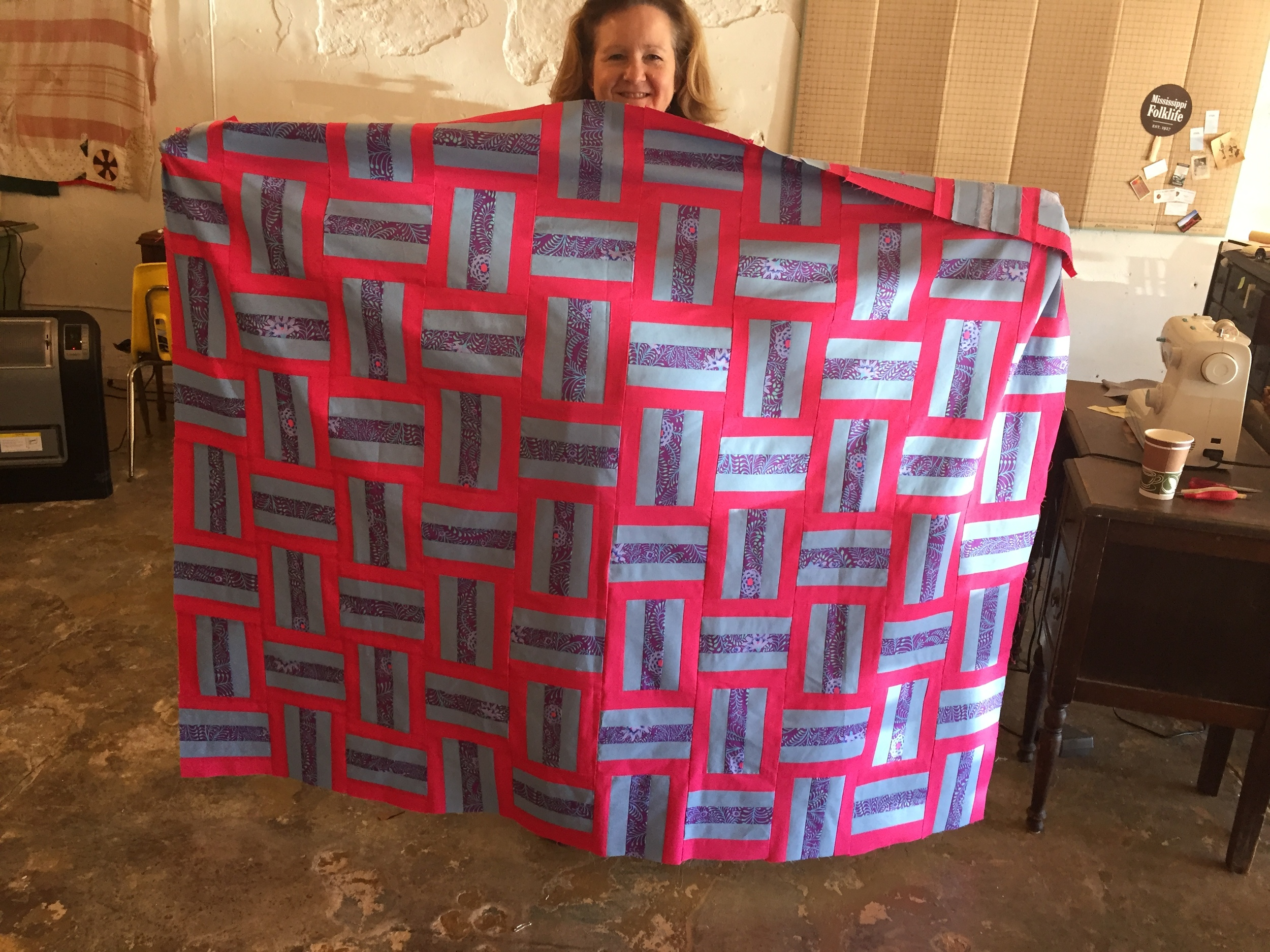 First-time quilter Susan Blackmon Watson with her terrific creation!