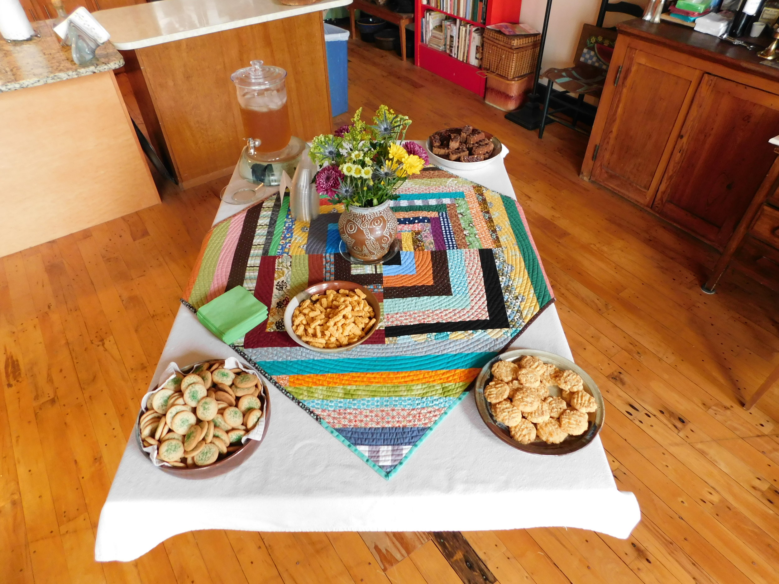 """This is the """"before"""" version. As guests arrived bearing offerings, the table became more heavily laden."""
