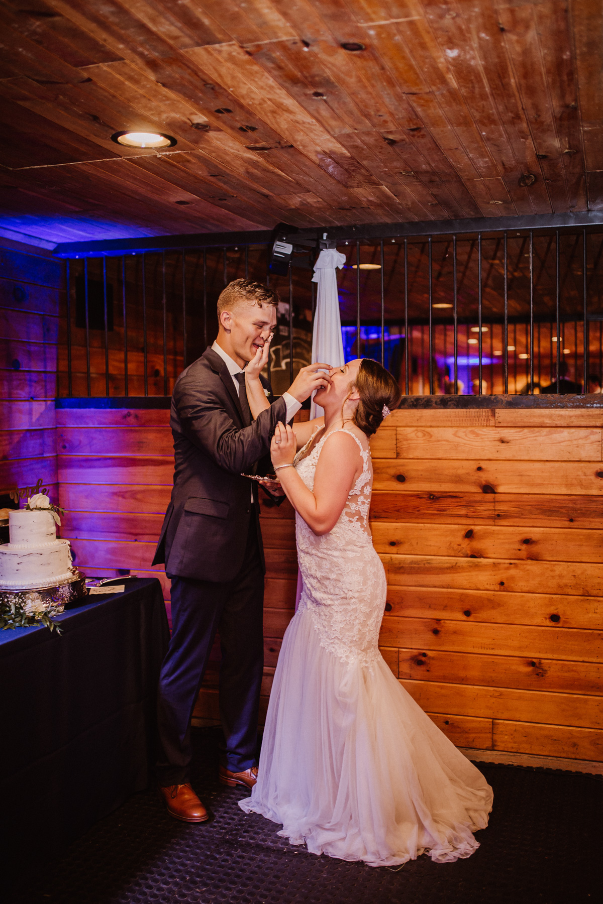 Cake cutting and dessert table at Millikan Farms wedding | Kayli LaFon Photography