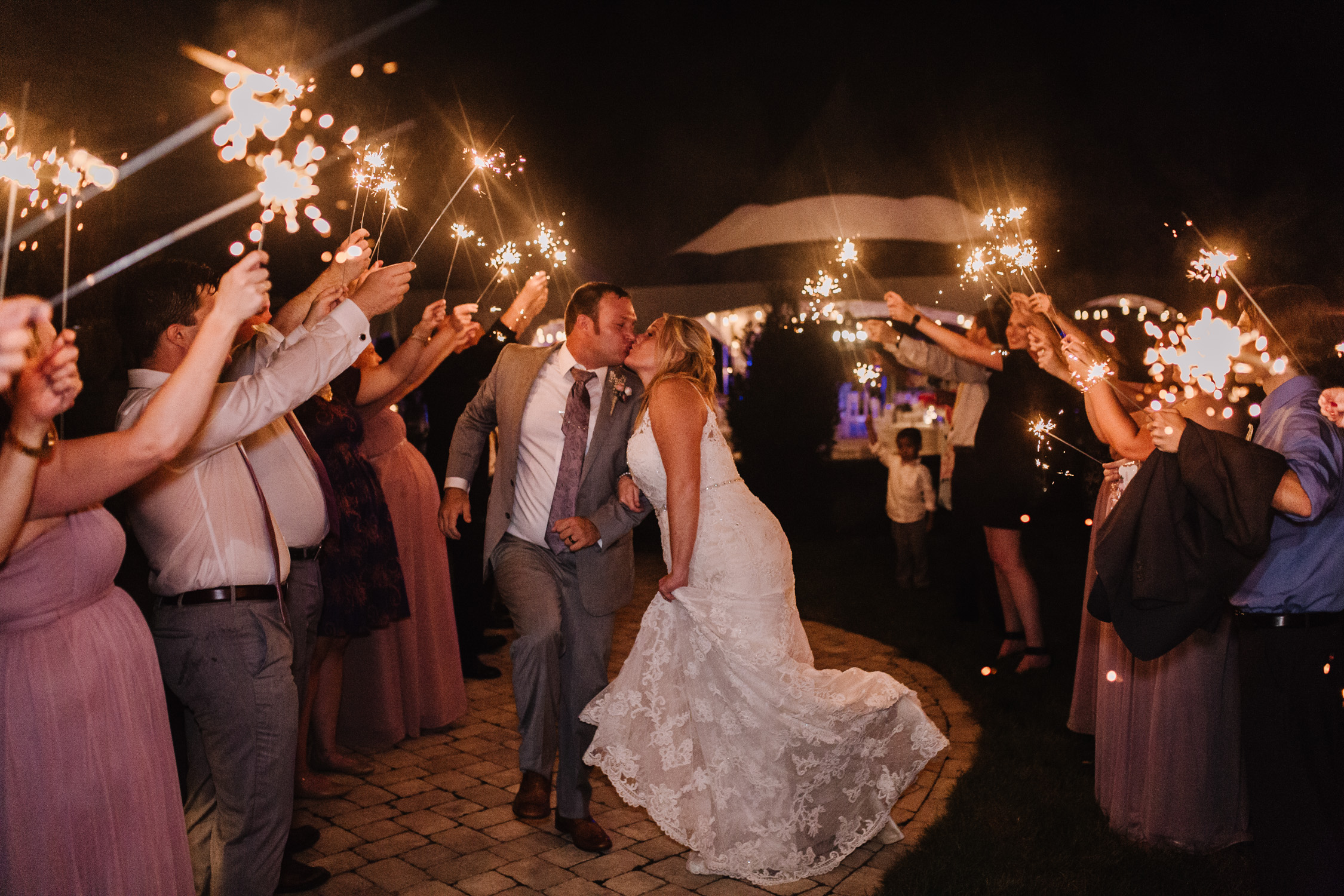 Sparkler exit by Kayli LaFon Photography | Greensboro Winston-Salem, NC Wedding Photographer | The Hideaway at Crooked Creek, Whitsett