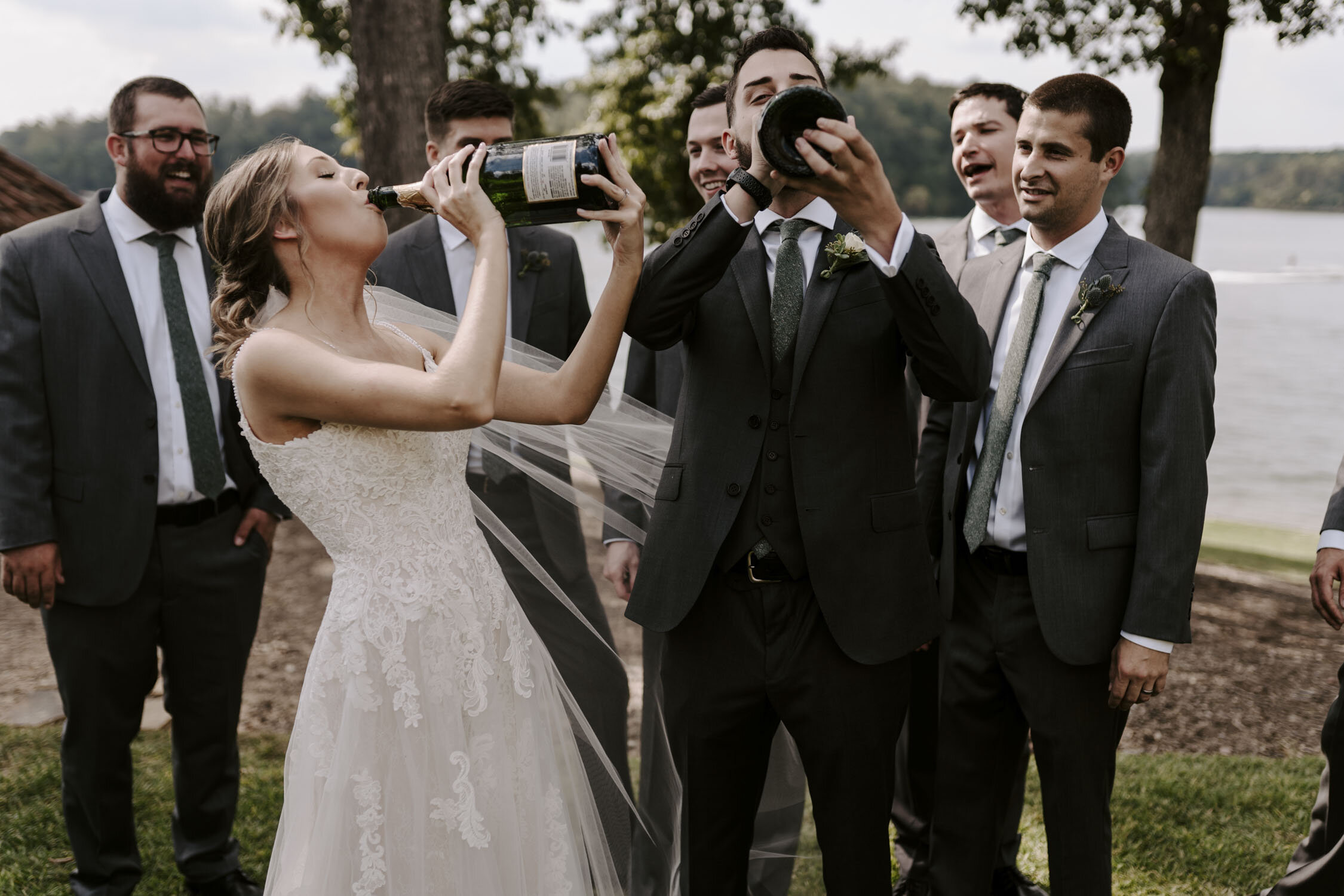 Fun Wedding Party Portraits popping champagne at Bella Collina   By Greensboro, NC Wedding Photographer: Kayli LaFon Photography