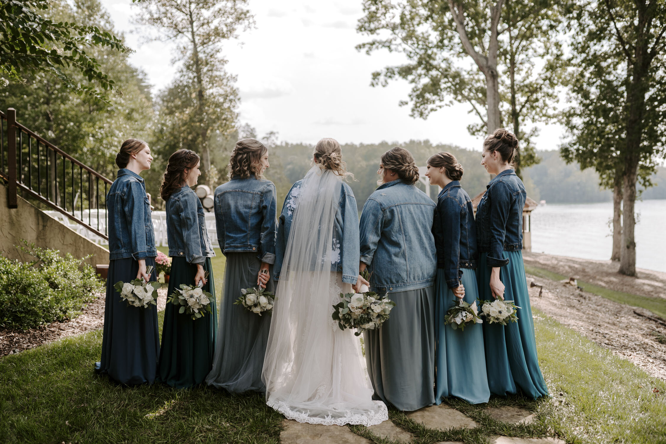 Fun Bridesmaids & wedding party portraits with cool denim jackets  at Bella Collina   By Greensboro, NC Wedding Photographer: Kayli LaFon Photography
