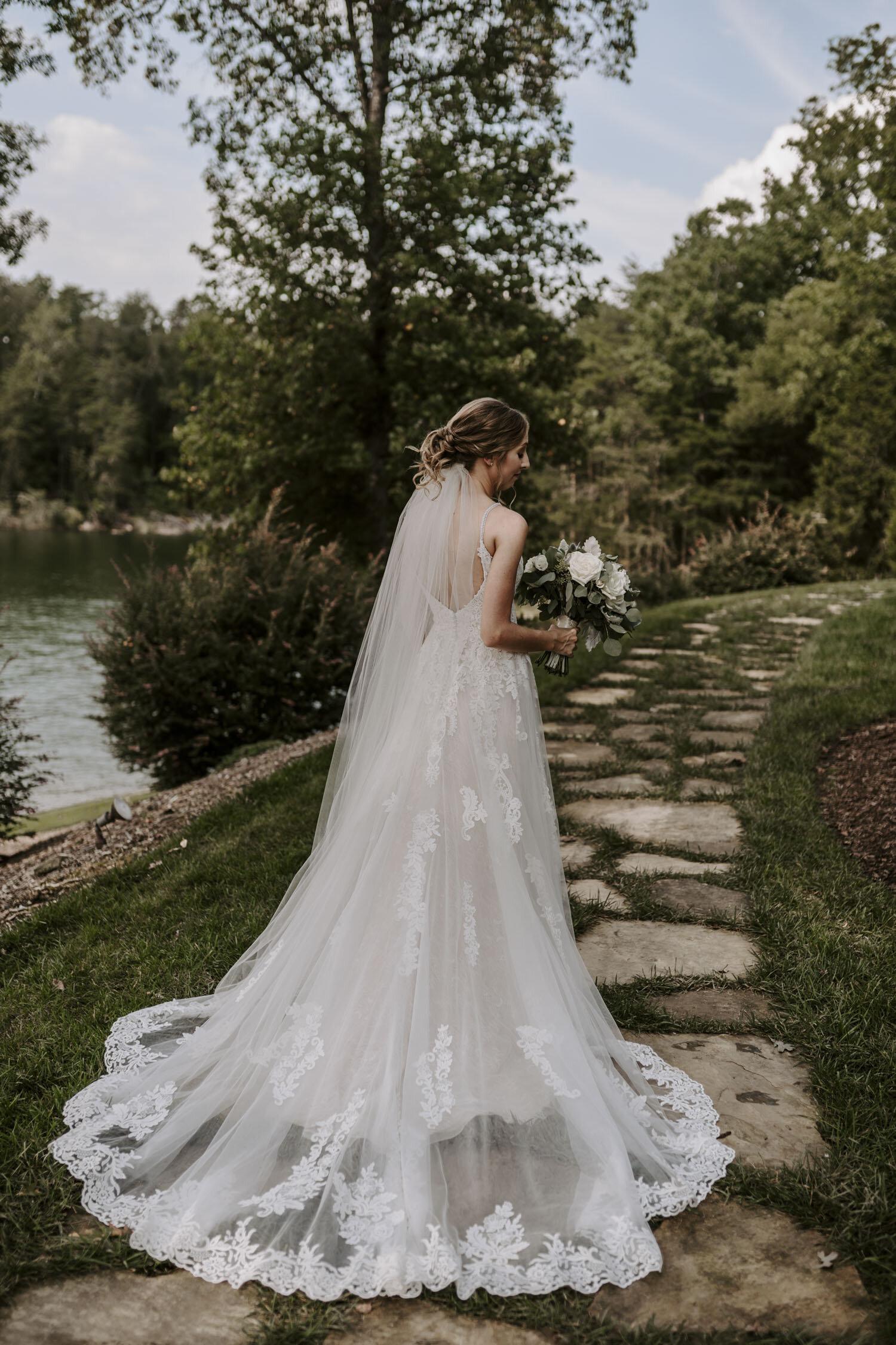 Romantic Bridal Portraits with denim jacket  at Bella Collina   By Greensboro, NC Wedding Photographer: Kayli LaFon Photography