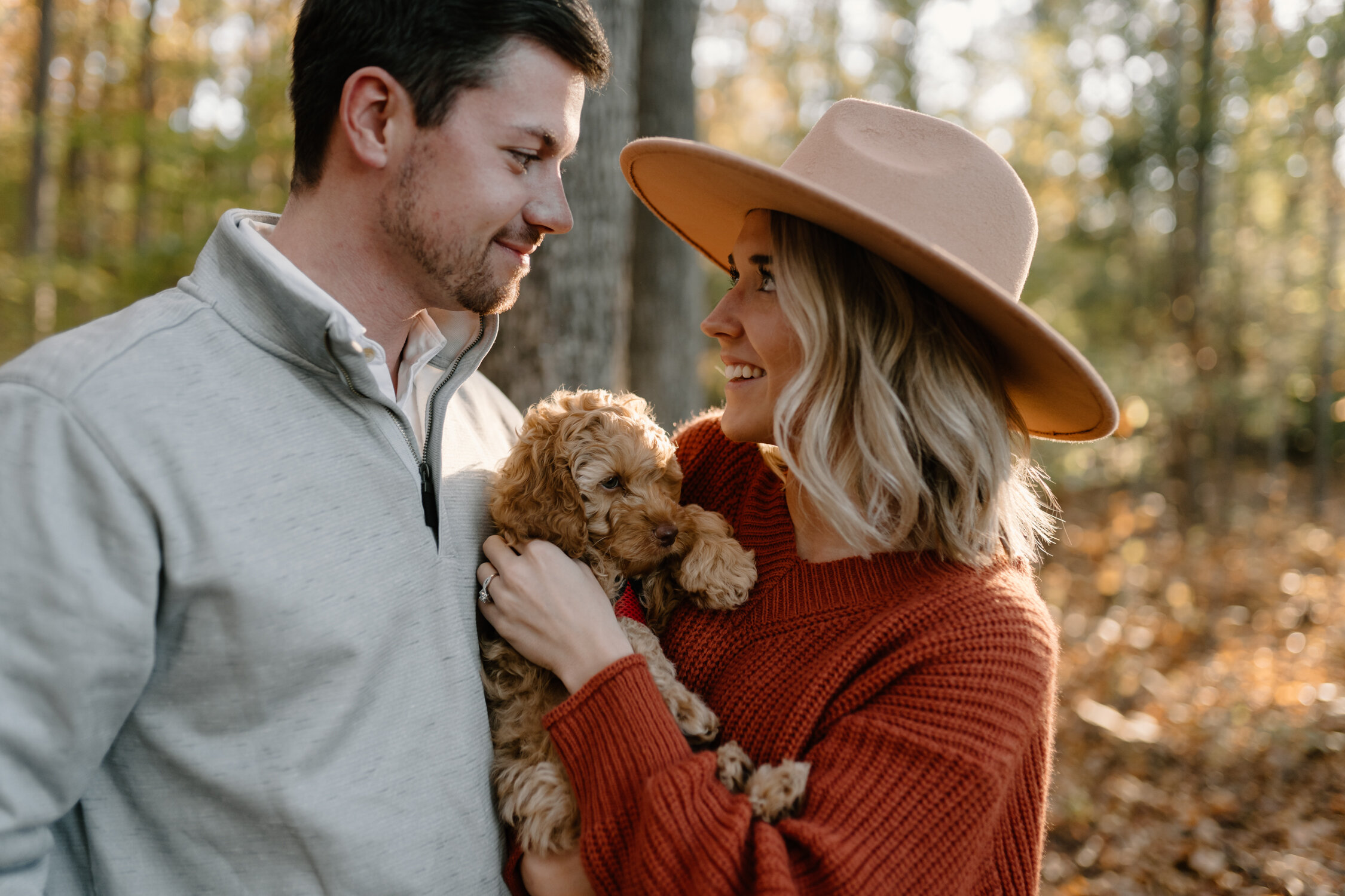 fluffy puppy hugs at engagement session