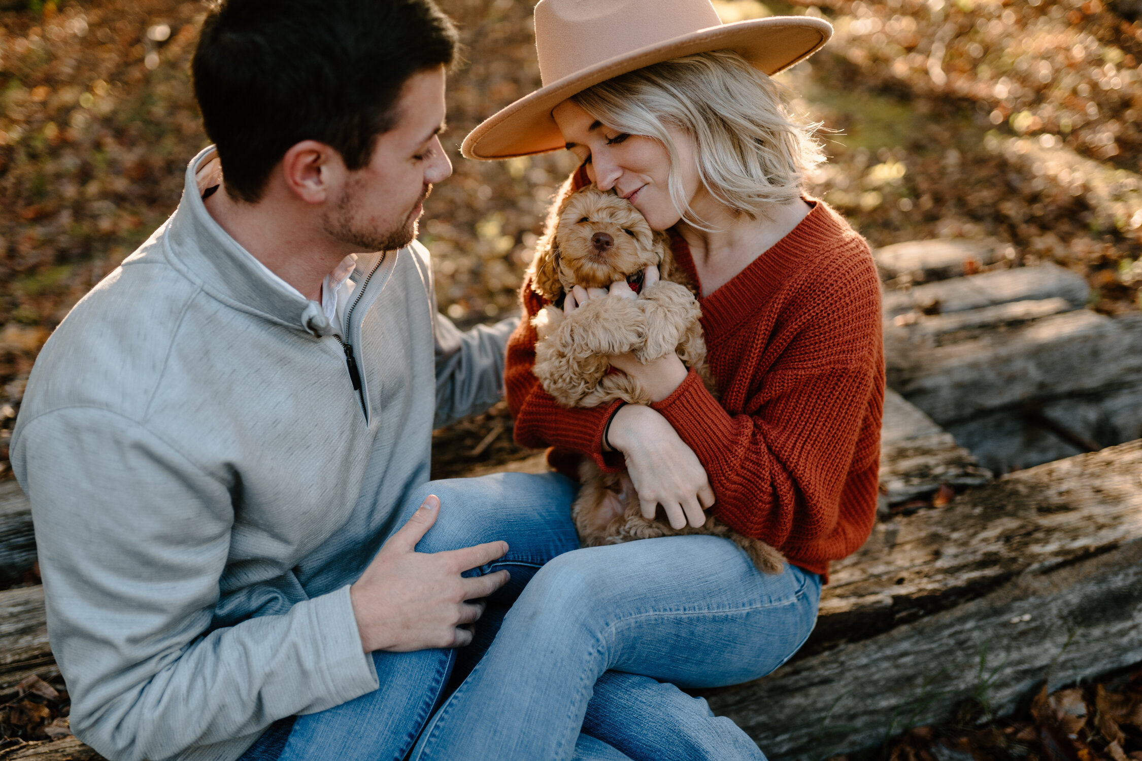 Giving puppy cuddles at fall engagement session in Greensboro, NC