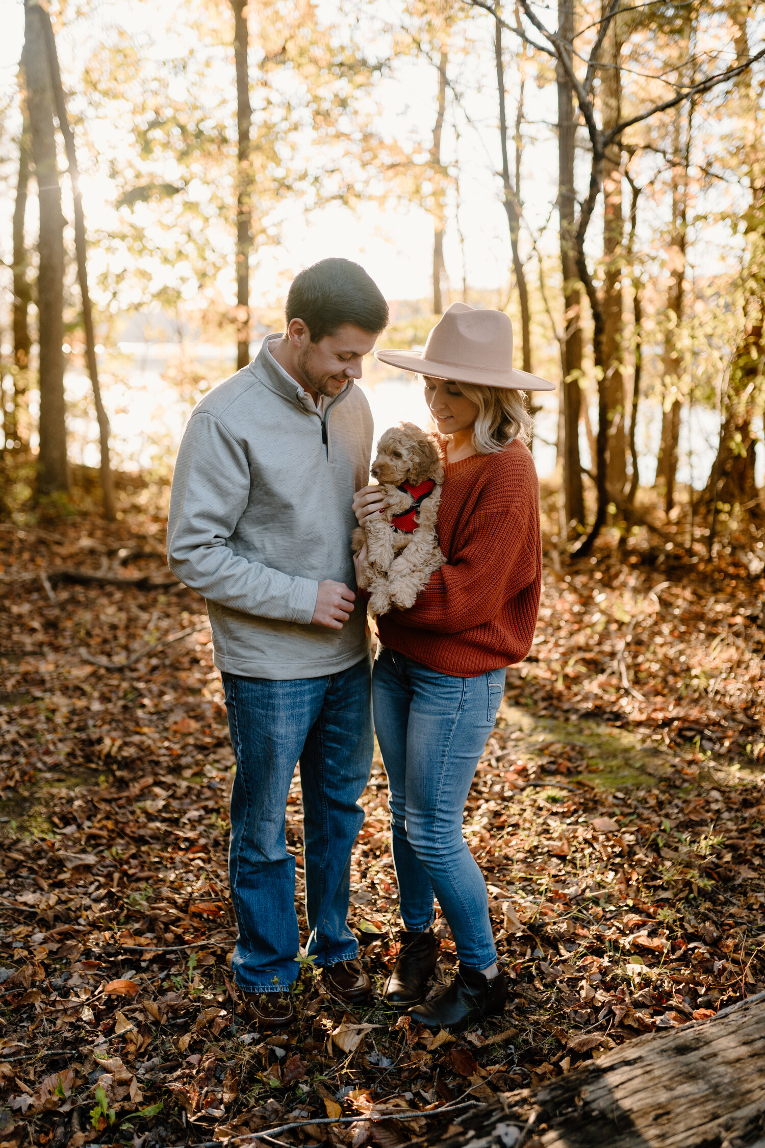 Engaged couple with brand new puppy