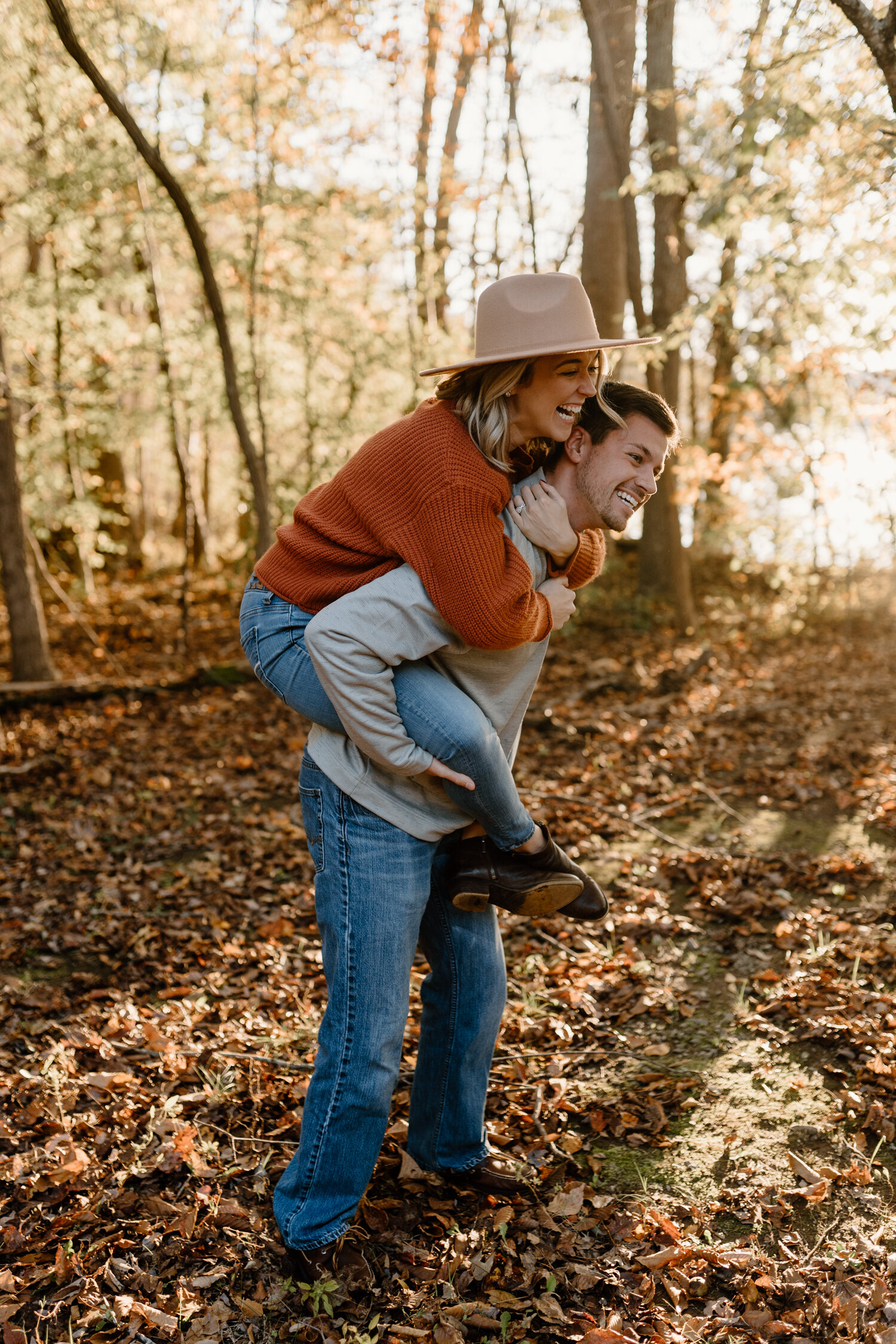 Couple's piggy back ride at fall engagement session in Greensboro NC